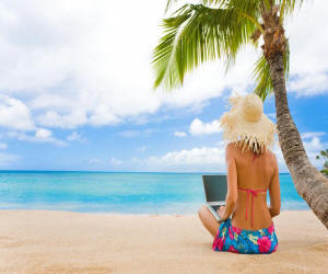 girl beach computer using free directory list to submit link